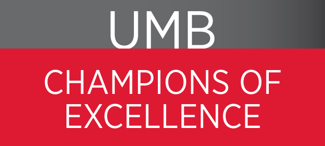 UMB Champions of Excellence text in a red and gray box.