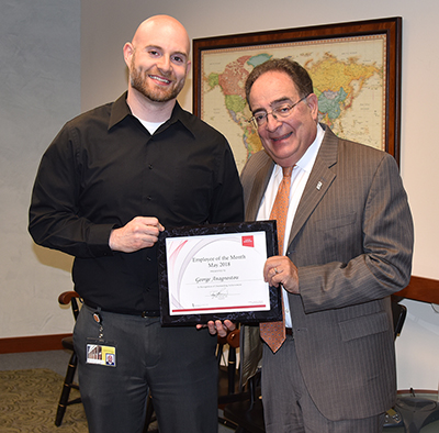 Employee of the Month George Anagnostou recieving his certificate from UMB's president