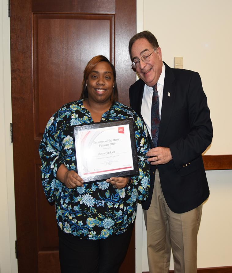 UMB's February 2019 Employee of the Month, Sheena Jackson, poses with University President Jay Perman.