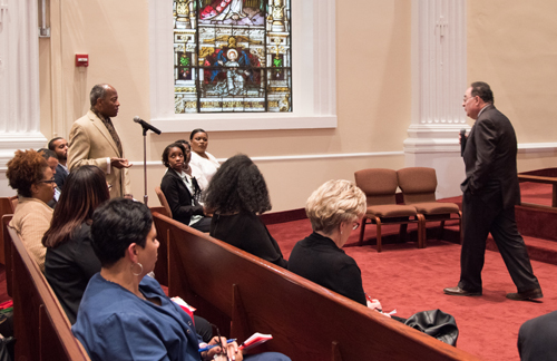 Wali Mutazammil, president of the Poppleton Community Neighborhood Association, poses a question to University of Maryland, Baltimore President Jay A. Perman, MD, at a town hall meeting for the Partnership for West Baltimore on May 4 at Carter Memorial Church of God In Christ.