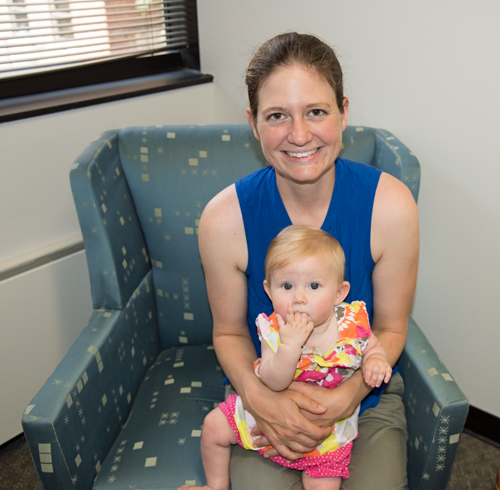 University of Maryland School of Social Work student Amy Greensfelder and her daughter, Georgianna Ashford, check out the school's new lactation center.
