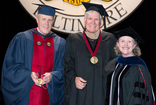 "From left, Bruce Jarrell, MD, FACS, chief academic and research officer, senior vice president, and Graduate School dean, William ""Bill"" Conway, and University of Maryland School of Nursing Dean Jane M. Kirschling, PhD, RN, FAAN, pose after Conway and his wife, Joanne, were awarded the Dean's Medal for Distinguished Service. The medals were handcrafted by Jarrell, an accomplished metal smith."