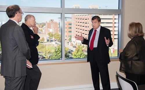 (l-r) BioPark President Jim Hughes, UMB Chief Academic and Research Officer Bruce Jarrell, Rep. Ruppersberger, and BioPark Senior Vice President Jane Shaab look out on the University of Maryland BioPark.