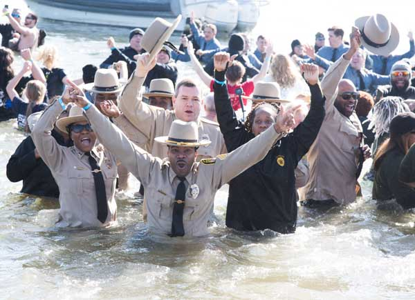 The University of Maryland, Baltimore Police Force Polar Bear Plunge team, UMB Cool, led by Sgt. Matthew Johnson (center), braves the icy Chesapeake Bay to raise money for Special Olympics Maryland.