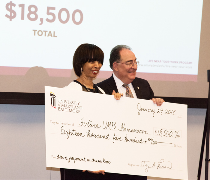 Baltimore Mayor Catherine Pugh praised University of Maryland, Baltimore President Jay A. Perman, MD, for UMB's commitment to offer an incentive of $16,000, which when combined with a city incentive, would give qualifying employees a total of $18,500 to help buy a home.