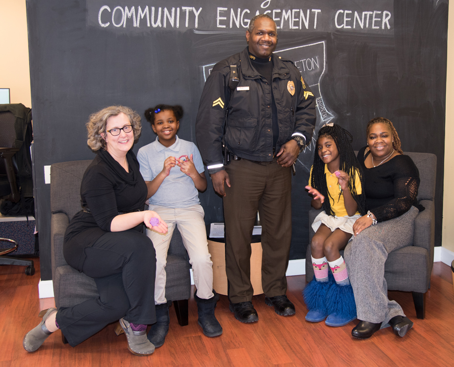 Students from James McHenry Elementary/Middle School take part in the PAL program under the leadership of (L to R) CEC Coordinator Kelly Quinn, Cpl. Eugene Douglass, and Cpl. Hazel Lewis.