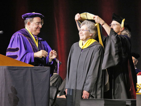 President Jay A. Perman, MD, and University of Maryland School of Nursing Dean Jane M. Kirschling, PhD, RN, FAAN, bestow an Honorary Doctor of Public Service degree upon Mary Catherine Bunting, MS '72, CRNP, an alumna of the School of Nursing who represented the Bunting family in 2017 when her grandfather, George Avery Bunting, was named a Founding Pharmapreneur by the School of Pharmacy.
