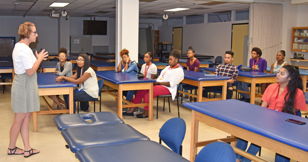 YouthWorks students listen to a physical therapy lecture at the School of Medicine.
