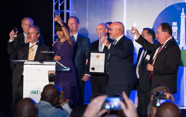 Toasting downtown success are (left to right) Peter Franchot, Kirby Fowler, Catherine Pugh, Kevin Pearson, Mike Murchie, Augie Chiasera, Amer Hammour, and Jay Perman.