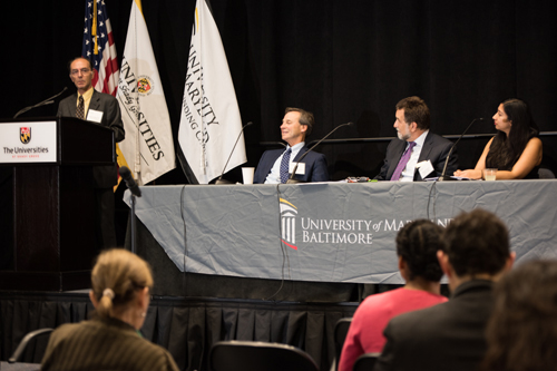 Professor Andrew Coop, PhD, FAAPS, associate dean for academic affairs at the School of Pharmacy, speaks about opioids research during a panel discussion including, l-to-r, Associate Professor Eric Weintraub, MD, of the School of Medicine, and Dean Richard Barth, PhD, MSW, and Associate Professor Nalini Negi, PhD, MSW, both of the School of Social Work.
