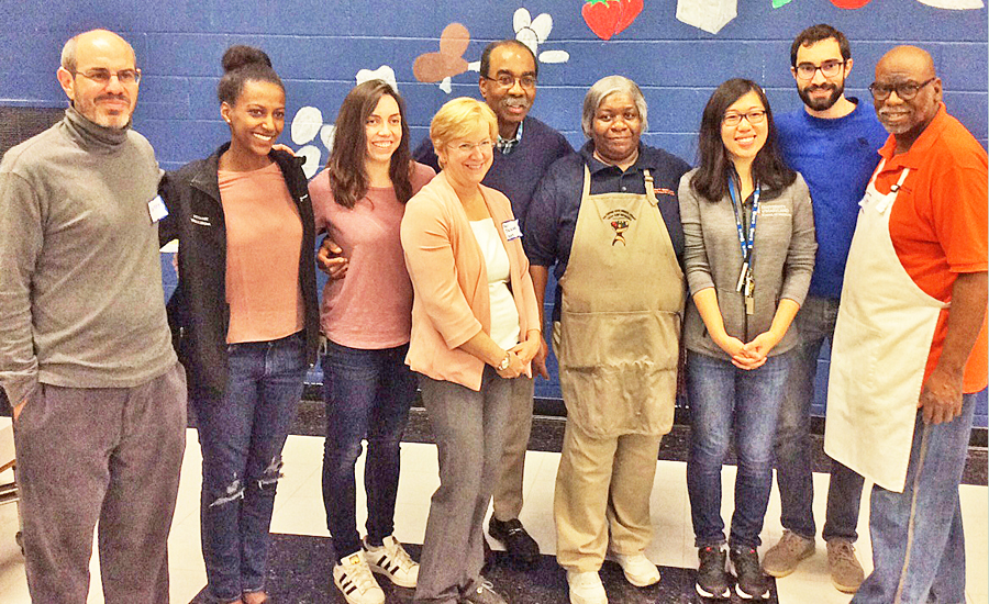 UMSOM Dean E. Albert Reece, MD, PhD, MBA, back row center; and Professors Sheri Slezak, MD, front center, and Anthony Harris, MD, far left; join Project Feast organizers Netsanet Woldegerima and Natalia Perez, second and third from left, and Alexander Thomopulos and Victoria Chen, second and third from right; and co-chefs Sheila Travers, fourth from right, and Clinton Tates, right.