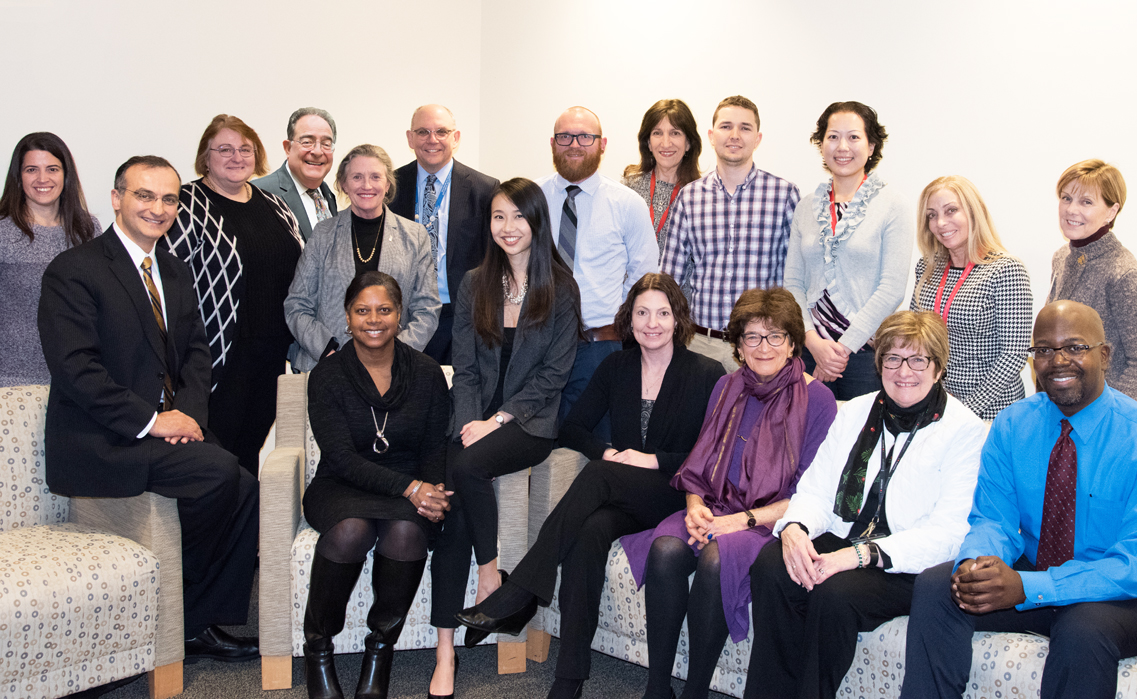 UMB President Jay A. Perman, MD, and School of Nursing Dean Jane M. Kirschling, PhD, RN, FAAN, director of the UMB Center for Interprofessional Education (IPE), fourth and fifth from left, with other leaders of the center and faculty members who were recipients of IPE seed grants.