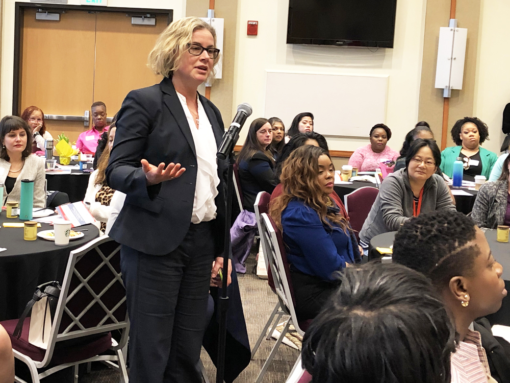 Megan Meyer, PhD, MSW, associate dean for academic affairs at the University of Maryland School of Social Work, asks about risk-taking during the question-and-answer session with entrepreneur Mei Xu, MA.