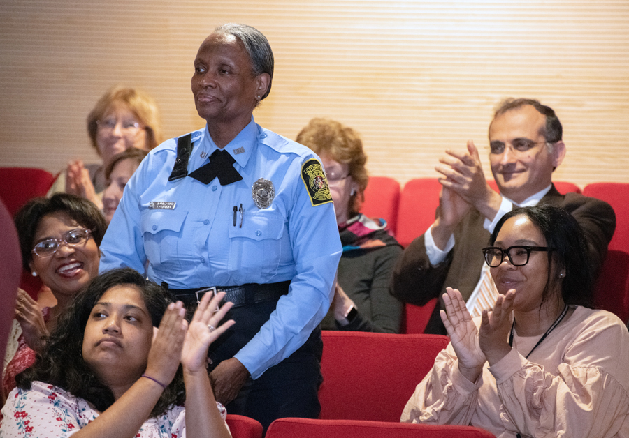 UMB security officer Evelyn Greenhill is applauded during the speech for the impact she is making as a mentor in the UMB CURE Scholars Program.