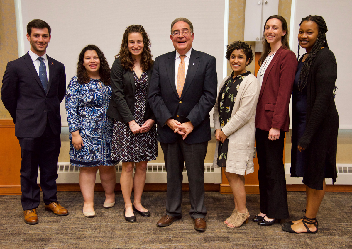 Left to right, President's Fellows Zachary Lee; Jenny Afkinich, MSW; and Jessica Egan; President Jay A. Perman, MD; and fellows Vibha Rao, MD '18, Nicole Campion Dialo, and Lauren Highsmith, MSW '19.