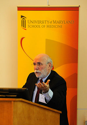 Myron Levine, PhD inset photo, shows Levine speaking at podium at the Festival of Science