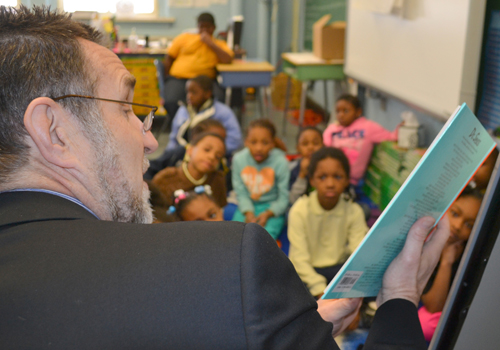Richard P. Barth, PhD, MSW reads to students of Promise Heights partner Historic Samuel P. Coleridge-Taylor Elementary School
