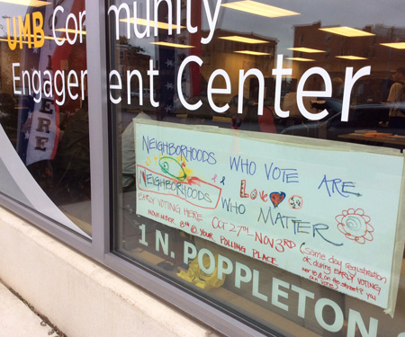 A poster made by University of Maryland, Baltimore neighbors who participate in programs at the Community Engagement Center is on view at the early voting site for Baltimore residents.