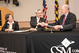 UMSON and CSM officials sign agreement.