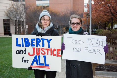 "Students Leslie Guthrie, left, and Chelsea Van Orden, participate in the ""UMB March for Civility."""