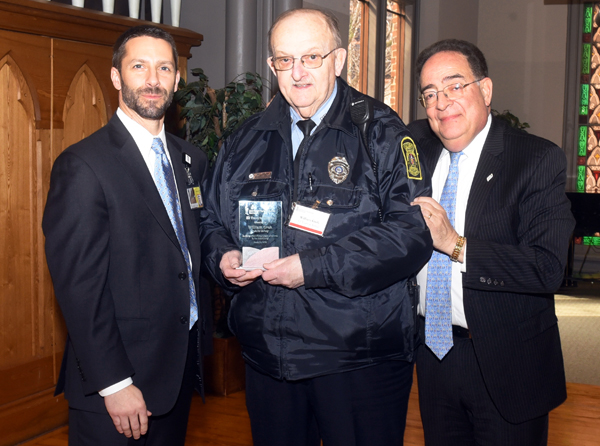 Officer William Groh of the Public Safety team, who came to UMB in 1964, was honored for his years of service by Matt Lasecki, SPHR, chief Human Resources officer, and President Jay A. Perman, MD.