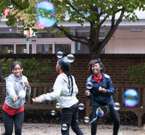 As an environmentally friendly alternative to releasing balloons, students from Edmondson-Westside High School have fun blowing bubbles to symbolize the launch of future health careers.