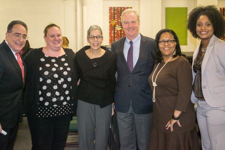 U.S. Rep. Chris Van Hollen of Maryland, third from right; joins UMB President Jay A. Perman, MD, left; the Family League of Baltimore's senior director of initiatives Julia Baez; Promise Heights executive director and SSW assistant dean Bronwyn Mayden, MSW; The Historic Samuel Coleridge-Taylor Elementary School principal Bettye Adams, and vice principal Twanda Pickett.