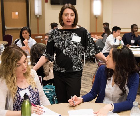 Heather Congdon, PharmD, BCPS, CDE, of the School of Pharmacy (SOP) mentors students Amanda Daugherty, right, of the School of Medicine's Physical Therapy and Rehabilitation Science program and Christine Do (SOP).