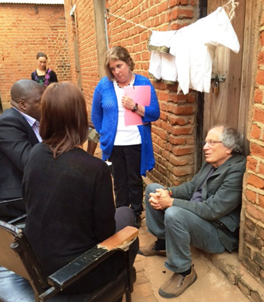 Maryland Carey Law professor Douglas Colbert, JD, right, and professor Rebecca Bowman-Rivas, MSW '99, LCSW, manager of the school's Law & Social Work Services Program, center, collaborate with students from UMB and from Chancellor College of Law during a visit to bail clients in Malawi's Zomba Central Prison.