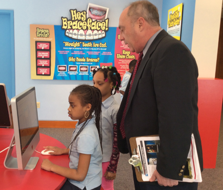 Richard Manski, DDS, PhD, MBA, executive director of the National Museum of Dentistry and professor and chair of Dental Public Health at the University of Maryland School of Dentistry, interacts with children who are in the second grade at Belmont Elementary School.