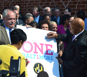 Mayor Stephanie Rawlings-Blake and Rep. Elijah Cummings are the first of many to sign a #OneBaltimore poster.