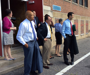 UMB President Jay A. Perman, MD, joins Promise Heights leaders and Congressmen Elijah Cummings and John Sarbanes on a tour of The Historic Samuel Coleridge-Taylor Elementary School.