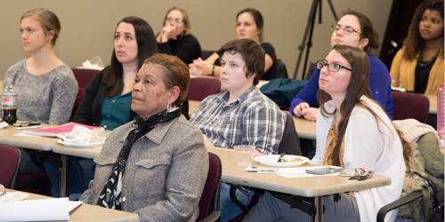 "Cynthia Rice, director of student development and leadership,(first row), and students listen to Michael Reisch, PhD, MSW, MA, speaks about ""Promoting Social Justice in a Divided Society."""