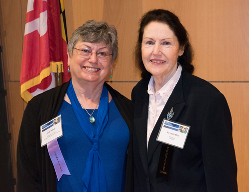 Judy Ozbolt (left), honored for her 46-year career in nursing informatics, appears with SINI conference co-chair Mary Etta Mills.
