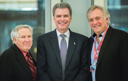University of Maryland School of Dentistry Dean Mark Reynolds, DDS '86, PhD, center, is shown with alumni committee members Edgar Sweren, DDS '54, left, and Karl Pick, DDS '66, right.