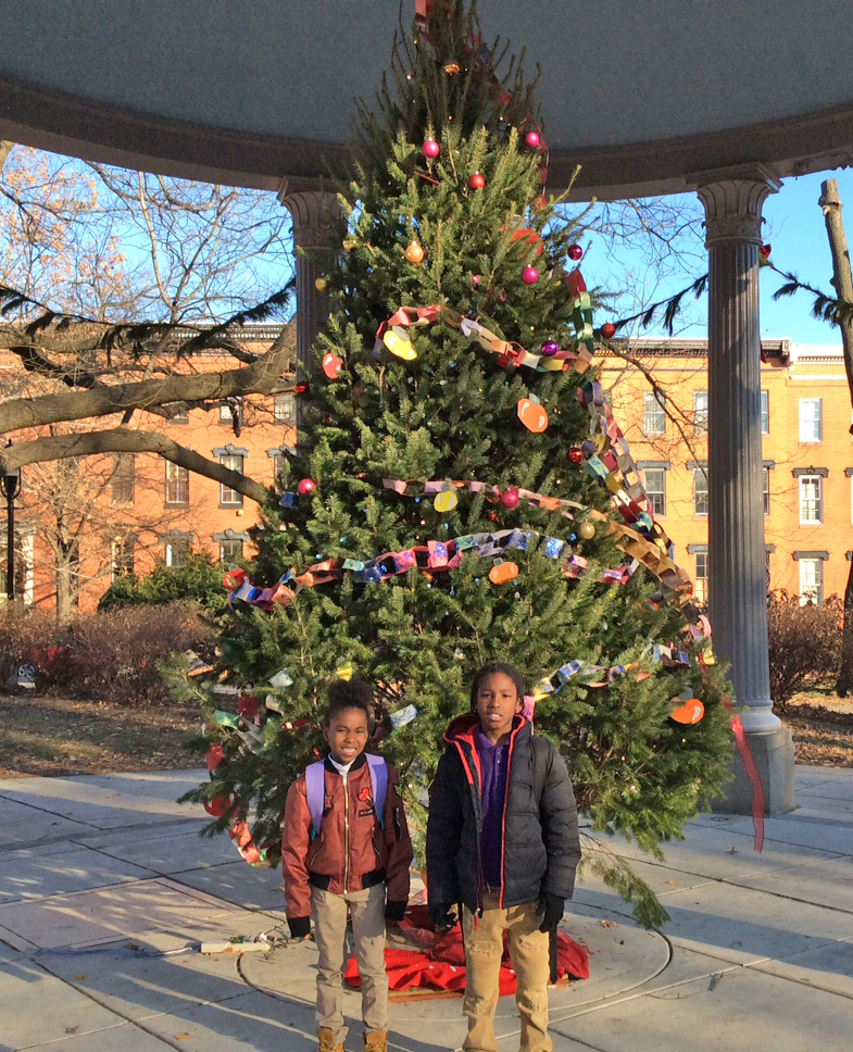 James McHenry Elementary/Middle School students Ti'yah and Robert pose at the Christmas tree in Union Square, one of seven neighborhoods in the Southwest Partnership.