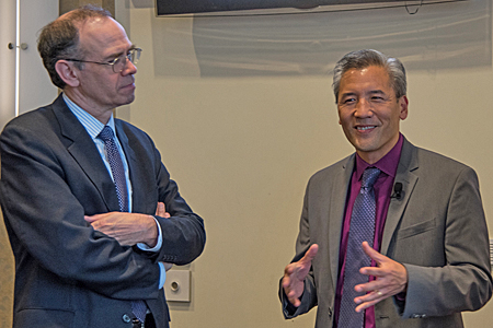 James L. Hughes, MBA, chief enterprise and economic development officer and vice president at UMB, left, speaks with Dean Chang, PhD, associate vice president for innovation & entrepreneurship at UMCP.