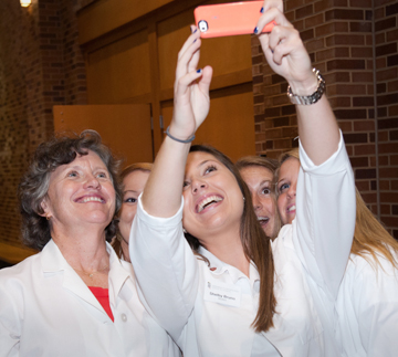 UMSON Dean Jane Kirschling and students take selfie