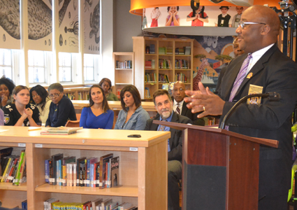 Milton D. Harrison of the Omega Psi Phi Fraternity speaks at an event launching the workforce program for families of students at The Historic Samuel Coleridge-Taylor Elementary School.