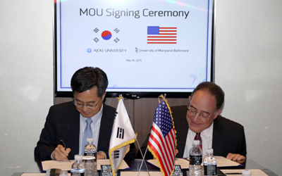 UMB President Jay Perman signs an MOU with Ajou University President Dong Yeon Kim in Korea.