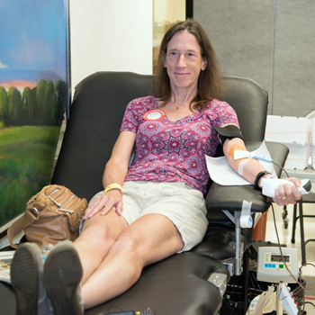 Melissa Regan donates in honor of Lamont Roberson at the blood drive held in his name.