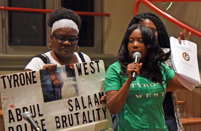 Tawanda Jones (right) tells the story of her brother, Tyrone West, who died in 2013 after being arrested during a traffic stop.