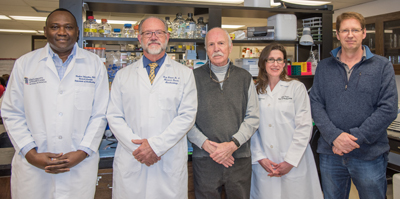 (l-r) Flaubert Tchantchou, PhD; Gary Fiskum, PhD; William Fourney, PhD; Julie Proctor, MS; Ulrich Leiste, PhD