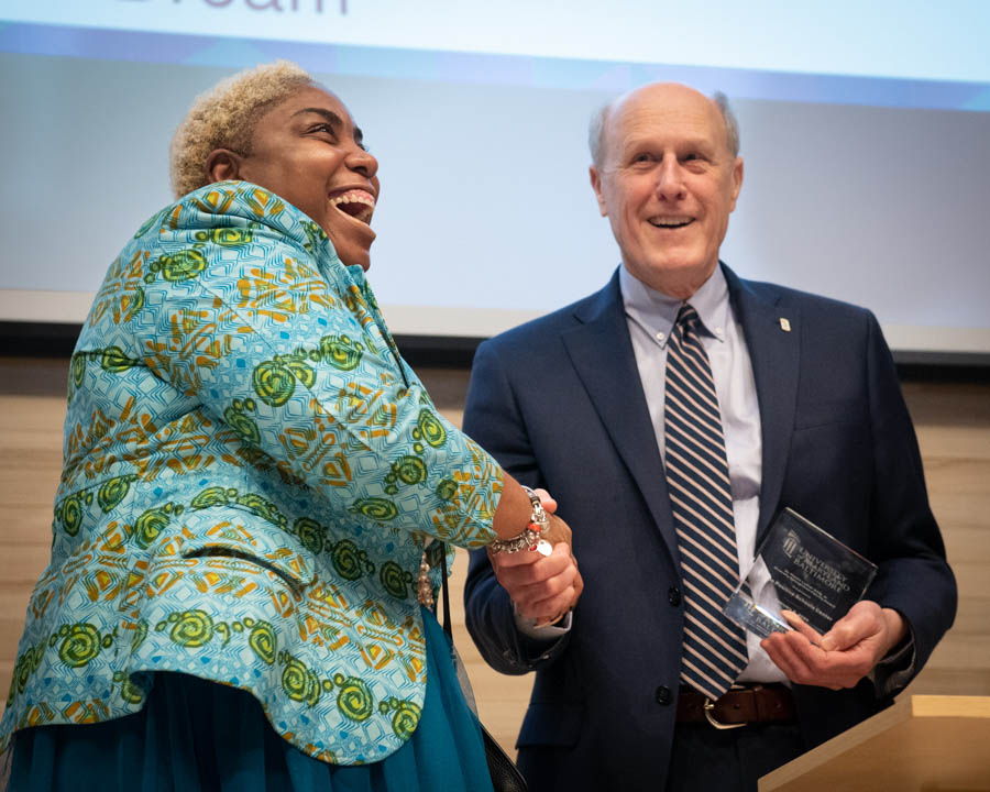 Shantay McKinily, MEd, director of the Positive Schools Center, accepts the Diversity Recognition Award for Outstanding UMB Faculty/Unit from UMB Interim President Bruce E. Jarrell, MD, FACS.