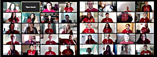 Members of the Physician Assistant Program Class of 2020 discuss their upcoming virtual learning assignments during a Zoom video conference call. Students and faculty were asked to show their school spirit by wearing UMB shirts.