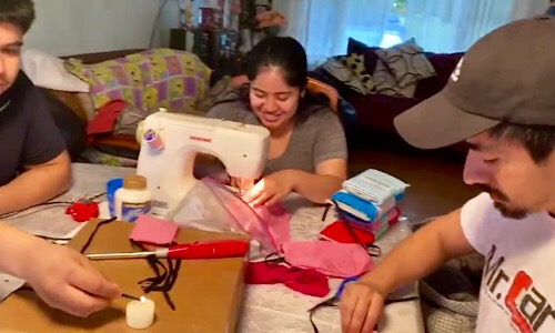 University of Maryland School of Nursing student Maria Segovia fires up her sewing machine to make cloth face masks as part of the school's mask donation drive.