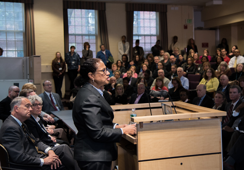Middle States evaluation team chair Denise V. Rodgers addresses UMB faculty, staff, and students in the School of Social Work auditorium.