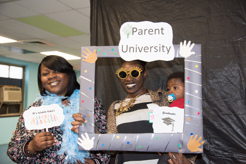 From left, Judy Center Family Coordinator Kimberly Dudley, (left) joins Parent University graduate Tawanda Thompson and her son, DeShaun, in a fun photo at the Parent University graduation ceremony.