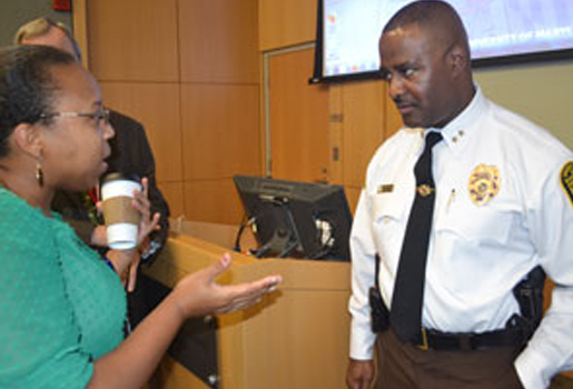 Chief Williams discusses UMB Safety with a Town Hall attendee. I entered this caption in the description field in the media library.