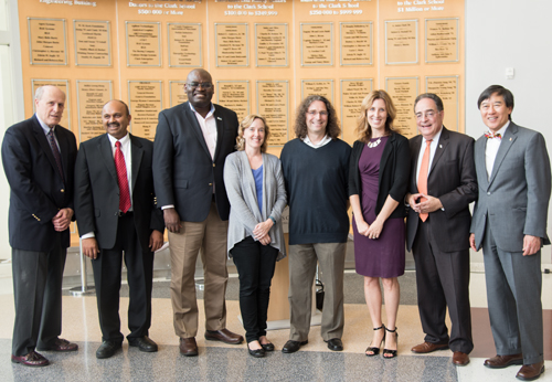 From left: Bruce E. Jarrell; Amitabh Varshney; Clement Adebamowo; Kathleen Stewart; Philip Resnik; Deanna Kelly; UMB President Jay A. Perman; and UMCP President Wallace D. Loh.